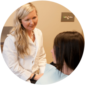 Image of Biological Dentist Dr. Kathryn Alderman discussing replacement of silver fillings with a patient in Lincoln, NE.