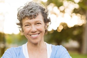 Image of a happy woman in Lincoln, NE who is wondering where she can get affordable dentures.