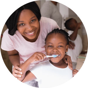 Image of a child brushing her teeth.